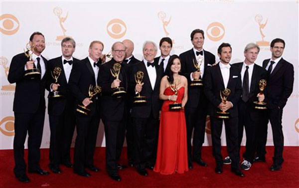Steven Levitan &#40;4th from R&#41; with producers, winners of outstanding comedy series for &#39;Modern Family,&#39; pose backstage with the award for Best Comedy Series at the 65th Primetime Emmy Awards at Nokia Theatre on Sunday Sept. 22, 2013, in Los Angeles.   <span class=meta>(Photo by Dan Steinberg&#47;Invision&#47;AP)</span>