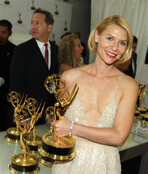 "<div class=""meta image-caption""><div class=""origin-logo origin-image ""><span></span></div><span class=""caption-text"">Exclusive - Claire Danes winner of the award for outstanding lead actress in a drama series for her role on ""Homeland"" is seen at the trophy table at the 65th Primetime Emmy Awards at Nokia Theatre on Sunday Sept. 22, 2013, in Los Angeles.   (Photo by Matt Sayles/Invision for Academy of Television Arts & Sciences/AP Images)</span></div>"