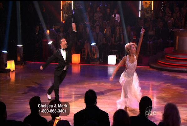 Chelsea Kane & Mark Ballas danced the Foxtrot during Week 1 of Season 12 of Dancing with the Stars. They received a score of 21.