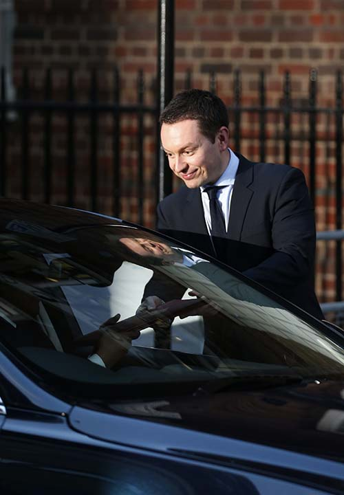 "<div class=""meta image-caption""><div class=""origin-logo origin-image ""><span></span></div><span class=""caption-text"">A Buckingham Palace official hands the birth announcement to colleague in a car to be driven to Buckingham Palace, outside St. Mary's Hospital exclusive Lindo Wing in London, Monday, July 22, 2013. Palace officials say Prince William's wife Kate has given birth to a baby boy. The baby was born at 4:24 p.m. and weighs 8 pounds 6 ounces.The infant will become third in line for the British throne after Prince Charles and William. (AP Photo/Lefteris Pitarakis)  </span></div>"