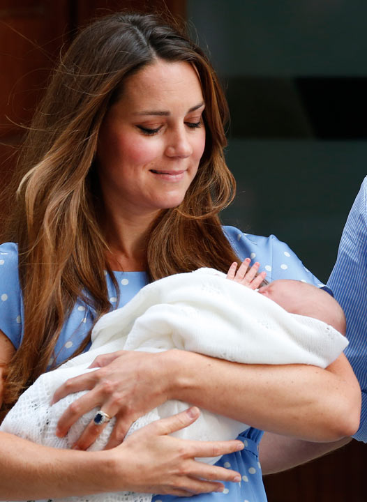 Kate, Duchess of Cambridge looks down as she holds the Prince of Cambridge, Tuesday July 23, 2013, as she poses for photographers outside St. Mary's Hospital exclusive Lindo Wing in London where the Duchess gave birth on Monday July 22. The Royal couple are expected to head to London's Kensington Palace from the hospital with their newly born son, the third in line to the British throne. (AP Photo/Lefteris Pitarakis)
