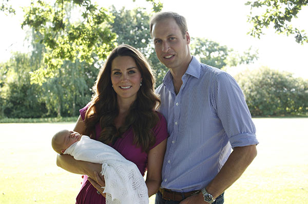 This image taken by Michael Middleton, the Duchess's father, in early August 2013 and supplied by Kensington Palace, shows the Duke and Duchess of Cambridge with their son, Prince George, in the garden of the Middleton family home in Bucklebury, England. (AP Photo/Michael Middleton/TRH The Duke and Duchess of Cambridge )