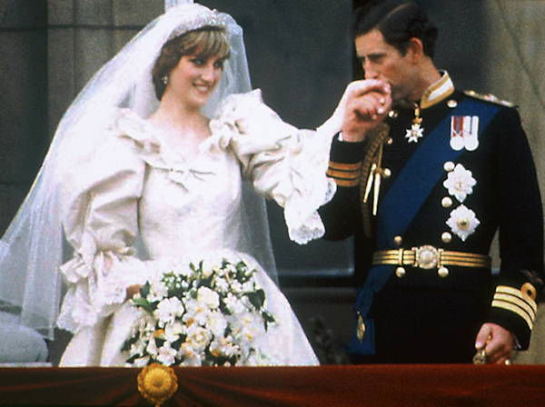 Prince Charles kisses the hand of his bride Princess Diana on the balcony of Buckingham Palace on their wedding day in London, England, July 29, 1981. <span class=meta>(AP Photo)</span>