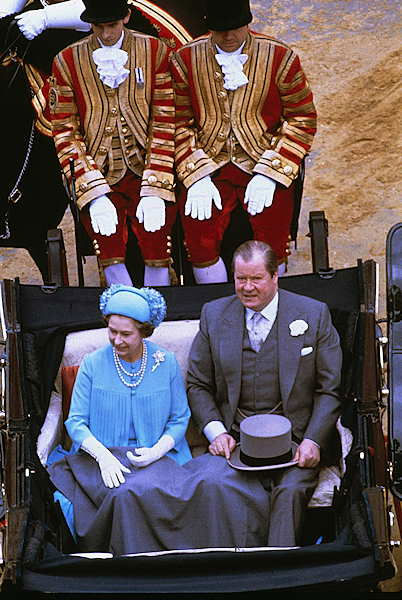 Queen Elizabeth II and Earl Spencer are shown in a carriage on their way to Buckingham Palace following the wedding of Princes Charles and the Princess of Wales at St. Paul&#39;s Church in London, July 29, 1981. <span class=meta>(AP Photo)</span>