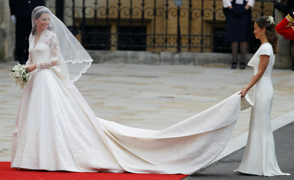 Kate Middleton, left, and accompanied by maid of honour Pippa Middleton as they arrive at Westminster Abbey at the Royal Wedding in London Friday, April 29, 2011. (AP Photo/Alastair Grant)
