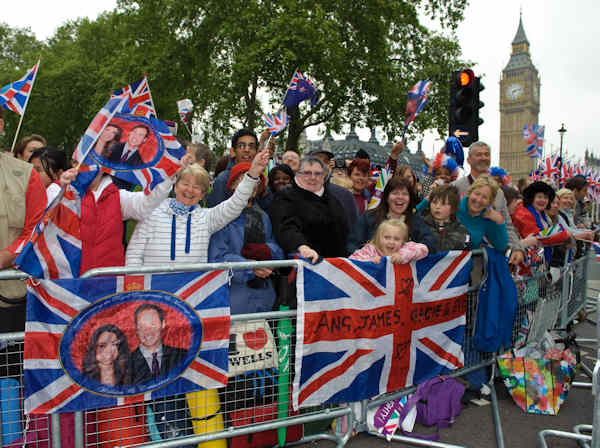 Enthusiastic crowds await the Royal Wedding in Parliament Square, London Friday, April, 29, 2011. (AP Photo/Fiona Hanson)