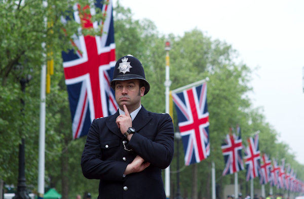 A policeman stands guard at the junction of the Mall and Horse Guards Road for the Royal Wedding in London Friday, April, 29, 2011. (AP Photo/Bogdan Maran)