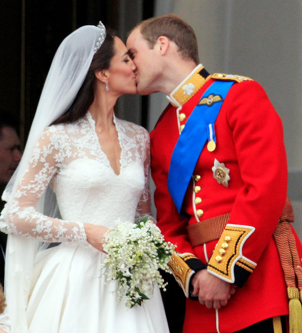 "<div class=""meta ""><span class=""caption-text "">Britain's Prince William kisses his wife Kate, Duchess of Cambridge on the balcony of Buckingham Palace after the Royal Wedding in London Friday, April, 29, 2011. (AP Photo/Matt Dunham)</span></div>"