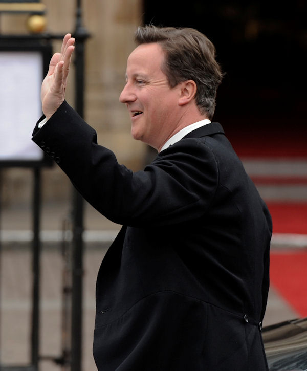 Britain's Prime Minister David Cameron arrives at Westminster Abbey at the Royal Wedding for Britain's Prince William and Kate Middleton in London Friday, April, 29, 2011. (AP Photo/Martin Meissner)