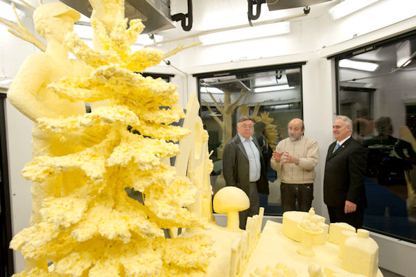 Pennsylvania Agriculture Secretary George Greig (right and Dairy Farmer Harold Shaulis, of Somerset County (left) listen as Jim Victor of Conshohocken, Montgomerty County, talks about his sculpture made from nearly 1,000 pounds of butter today at the Pennsylvania Farm Show, paying tribute to Pennsylvania's diverse agriculture industry.