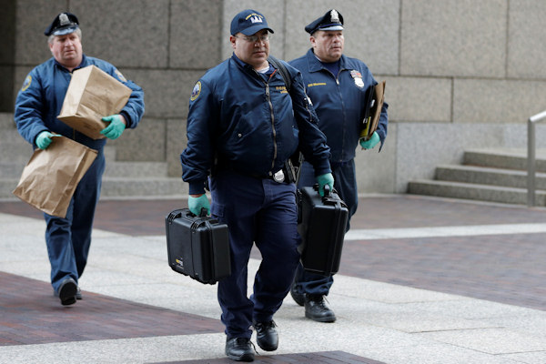 "<div class=""meta ""><span class=""caption-text "">Philadelphia Police officers with the Crime Scene Unit walk away from the Four Seasons Hotel Tuesday, Jan. 8, 2013, in Philadelphia. Philadelphia police are investigating a possible sexual assault at the upscale hotel, and the Brooklyn Nets say the probe involves one of the team's players. (AP Photo/Matt Rourke)  </span></div>"