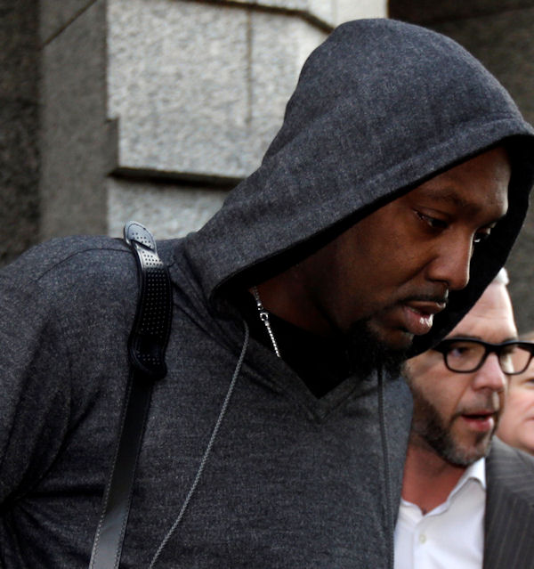 "Brooklyn Nets forward Andray Blatche, center left, exits the Four Seasons Hotel, Tuesday, Jan. 8, 2013, in Philadelphia. Philadelphia police are investigating a possible sexual assault at the upscale hotel, and the Nets say the probe involves one of the team's players. On Tuesday, Blatche tweeted, ""Im ok and I didn't do anything jus was n the area when it happened."" He later took down the tweet. (AP Photo/Matt Rourke)"
