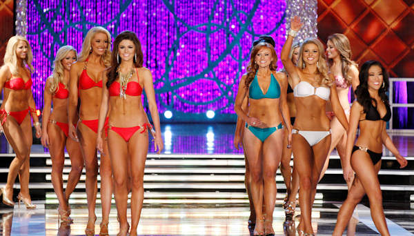 "<div class=""meta ""><span class=""caption-text "">Contestants compete in the swimsuit portion of the Miss America 2013 pageant on Saturday, Jan. 12, 2013, in Las Vegas. (AP Photo/Isaac Brekken)   </span></div>"