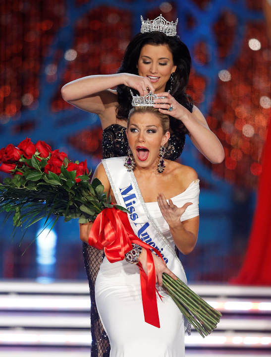 "<div class=""meta ""><span class=""caption-text "">Miss New York Mallory Hagan is crowned Miss America 2013 by Miss America 2012 Laura Kaeppeler on Saturday, Jan. 12, 2013, in Las Vegas. (AP Photo/Isaac Brekken)    </span></div>"