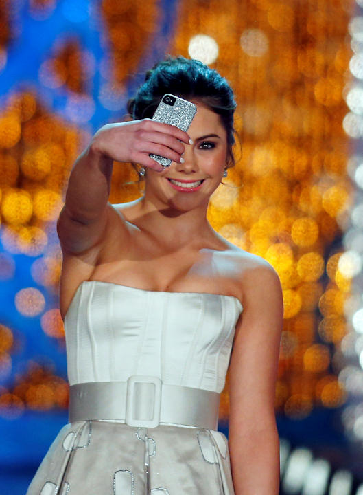 "<div class=""meta ""><span class=""caption-text "">Miss America judge McKayla Maroney photographs herself onstage before the pageant on Saturday, Jan. 12, 2013, in Las Vegas. (AP Photo/Isaac Brekken)     </span></div>"