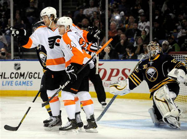 "<div class=""meta ""><span class=""caption-text "">Philadelphia Flyers center Sean Couturier (14) celebrates his second-period goal with right winger Matt Read (24) as Buffalo Sabres' goaltender Ryan Miller (30) reacts during the season opener of an NHL hockey game in Buffalo, N.Y., Sunday, Jan. 20, 2013. (AP Photo/Gary Wiepert)</span></div>"