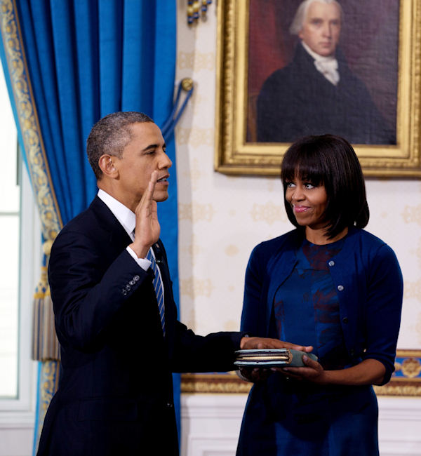President Obama takes the oath of office at the official swearing-in ceremony in the Blue Room of the White House Sunday, Jan. 20, 2013. Holding the Bible is first lady Michele Obama. (AP Photo/Doug Mills, The New York Times, Pool)
