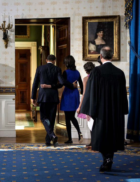 "<div class=""meta ""><span class=""caption-text "">President Barack Obama walks with his daughter Malia as first lady Michelle Obama and daughter Sasha and Chief Justice John Roberts as they leave the Blue Room after being oficially sworn-in by Chief Justice John Roberts, back in the Blue Room of the White House during the 57th Presidential Inauguration in Washington, Sunday, Jan. 20, 2013. (AP Photo/Brendan Smialowsi, Pool)   </span></div>"