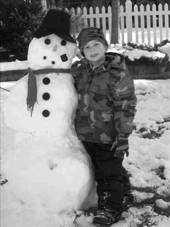 Luca is all smiles after building a snowman with his big cousin Meg. <span class=meta>(Action News viewer Meg)</span>