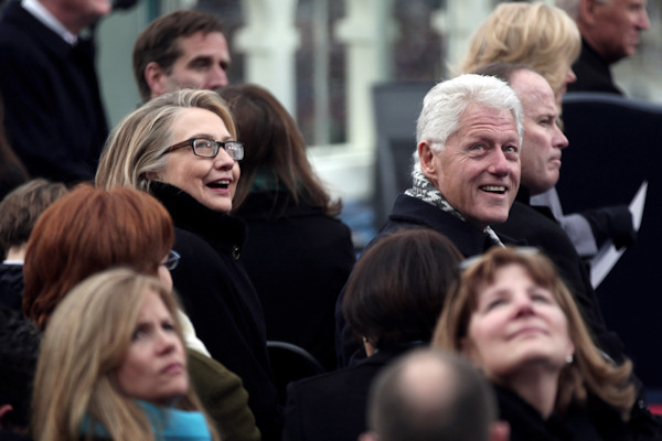"<div class=""meta image-caption""><div class=""origin-logo origin-image ""><span></span></div><span class=""caption-text"">Secretary of State Hillary Rodham Clinton and former president Bill Clinton look on during the ceremonial swearing-in ceremony during the 57th President Inauguration, Monday, Jan. 21, 2013, on the West Front of the Capitol in Washington. (AP Photo/Win McNamee, Pool)  </span></div>"