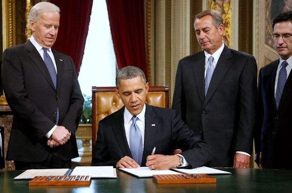 President Barack Obama signs a proclamation to commemorate the inauguration, entitled a National Day of Hope and Resolve, on Capitol Hill in Washington, Monday, Jan. 21, 2013, following his ceremonial swearing-in ceremony during the 57th Presidential Inauguration. From, left are, Vice President Joe Biden, House Speaker John Boehner of Ohio and House Majority Leader Eric Cantor of Va. (AP Photo/Jonathan Ernst, Pool)