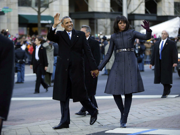 "<div class=""meta image-caption""><div class=""origin-logo origin-image ""><span></span></div><span class=""caption-text"">President Barack Obama and first lady Michelle Obama walk down Pennsylvania Avenue during the 57th Presidential Inauguration parade Monday, Jan. 21, 2013, in Washington. (AP Photo/Charles Dharapak)    </span></div>"