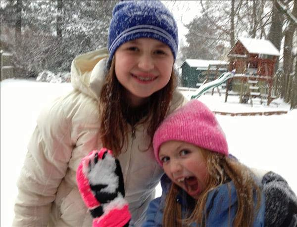 Grace and Molly from Paoli. Molly about to hit Mom with some snow.
