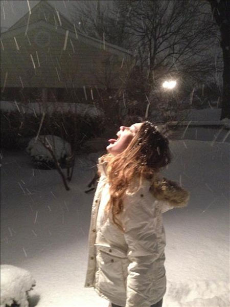 Kayla Roberts catching snowflakes in King of Prussia