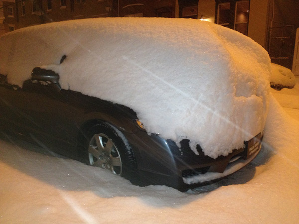 Photo: Car parked on 24th Street at Christian with snow more than 2 feet high on hood.