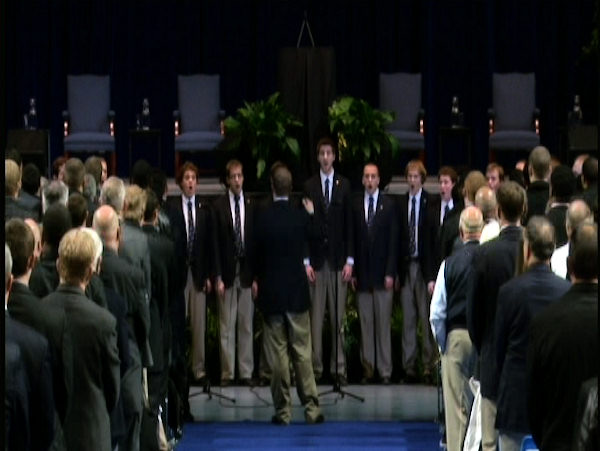 The Penn State University Glee Club performs the school's alma mater at the public memorial for Joe Paterno at Penn State's Bryce Jordan Center, January 26, 2012.