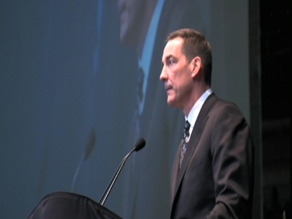 Former Penn State football player Todd Blackledge speaks at the public memorial for Joe Paterno at Penn State's Bryce Jordan Center, January 26, 2012.