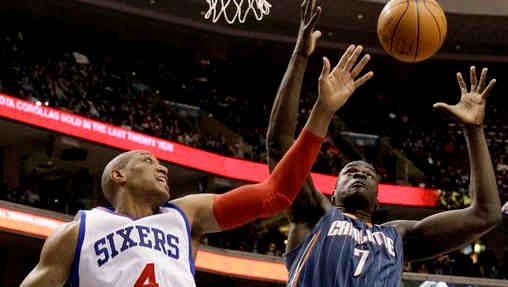 Philadelphia 76ers' Tony Battie (4) and Charlotte Bobcats' DeSagana Diop (7), of Senegal, battle for a rebound in the first half of an NBA basketball game, Friday, Jan. 27, 2012, in Philadelphia. (AP Photo/Matt Slocum)
