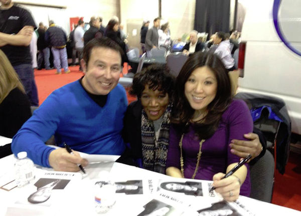 Dann Cuellar and Nydia Han greet an Action News viewer at the 2012 Philadelphia Auto Show.
