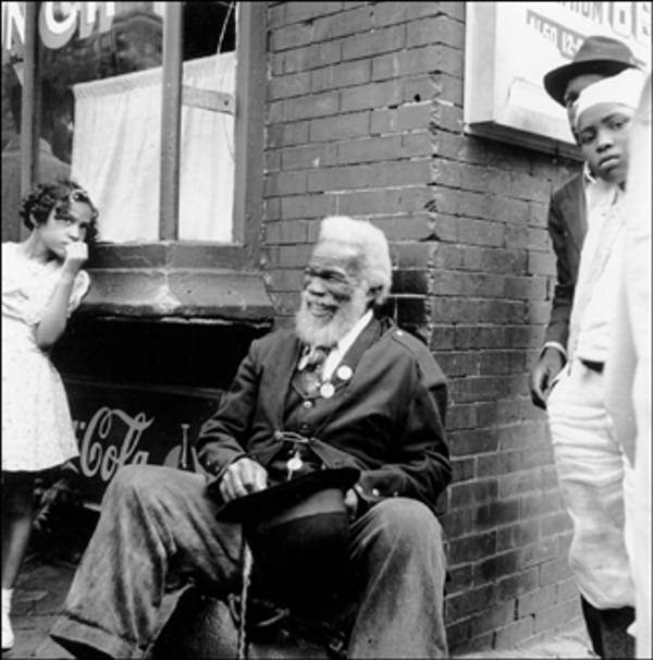 Big Quarterly August 27, 1939 Gentleman sits, smiling outside a store.    The Delaware Historical Society wants to know if you can identify anyone in this photo.  If you have any information, email hischumacher@dehistory.org