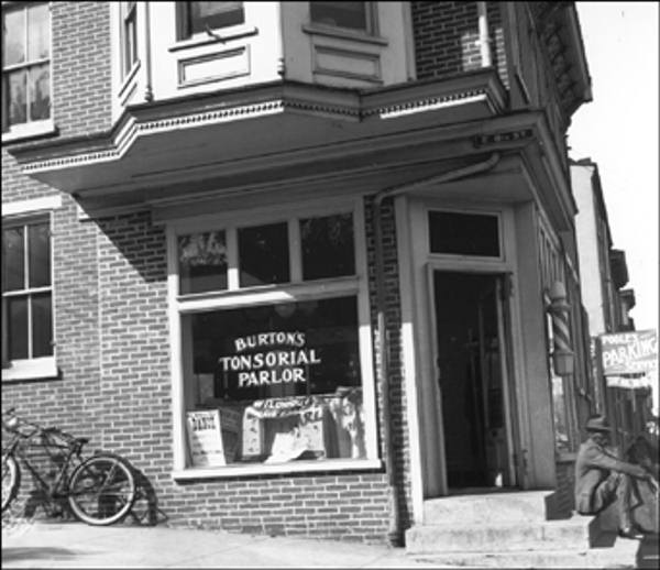 Burton's Tonsorial Parlor 801 Walnut Street, Wilmington March 1939 Exterior view    The Delaware Historical Society wants to know if you can identify anyone in this photo.  If you have any information, email hischumacher@dehistory.org