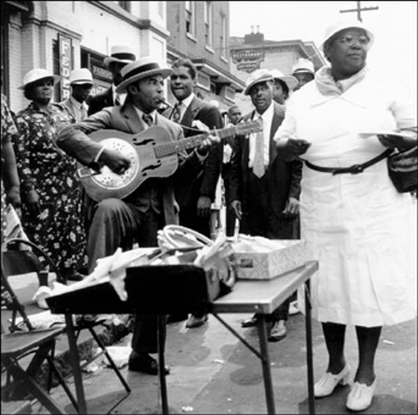 "<div class=""meta ""><span class=""caption-text "">Big Quarterly August 27, 1939 Man playing guitar and singing on street.     The Delaware Historical Society wants to know if you can identify anyone in this photo.  If you have any information, email hischumacher@dehistory.org  </span></div>"