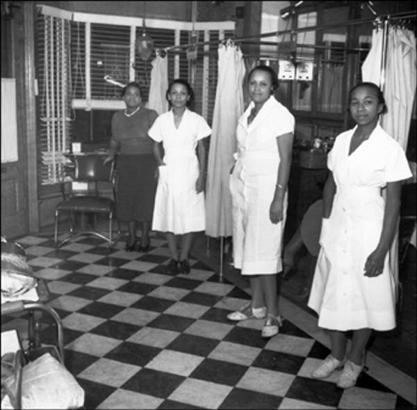 Estella's Beauty Salon 819 Poplar Street April 1939 Estella Hodges and hairdressers inside the shop.    The Delaware Historical Society wants to know if you can identify anyone in this photo.  If you have any information, email hischumacher@dehistory.org
