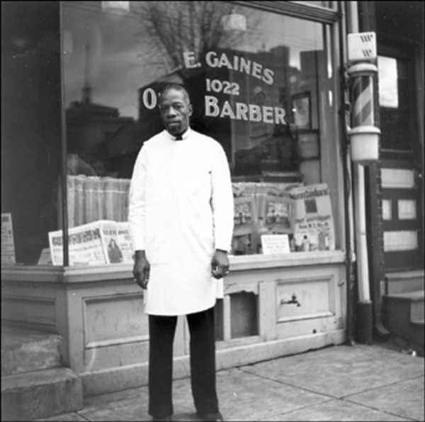 L.E. Gaines Barber Shop 1022 Walnut Street, Wilmington December 31, 1938 Mr. Gaines stands outside his shop.    The Delaware Historical Society wants to know if you can identify anyone in this photo.  If you have any information, email hischumacher@dehistory.org