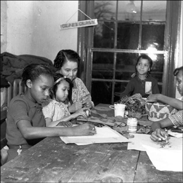 Garrett Settlement House 301 East 7th Street,Wilmington June, 1939 Children with teacher Mrs. Sadie Peterson in craft class.    The Delaware Historical Society wants to know if you can identify anyone in this photo.  If you have any information, email hischumacher@dehistory.org