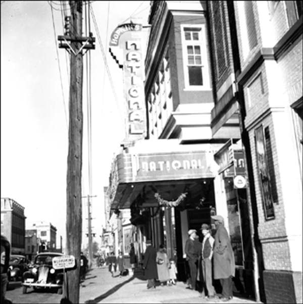 "<div class=""meta ""><span class=""caption-text "">National Theater 910-812 French Street, Wilmington December 4, 1938 Looking along French Street.    The Delaware Historical Society wants to know if you can identify anyone in this photo.  If you have any information, email hischumacher@dehistory.org</span></div>"