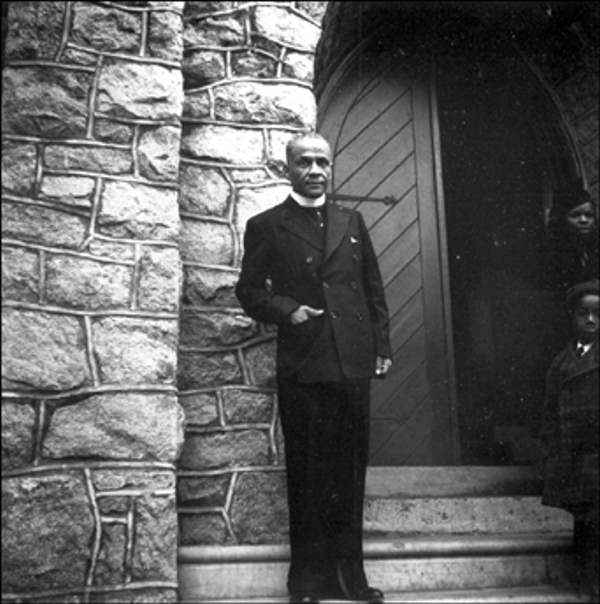 Rev. A. Chester Clark Bethel A.M.E. Church January 2, 1939 Outside the front door of the church.    The Delaware Historical Society wants to know if you can identify anyone in this photo.  If you have any information, email hischumacher@dehistory.org