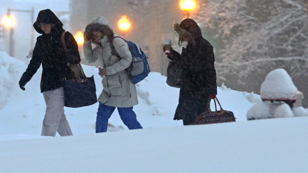 "<div class=""meta ""><span class=""caption-text "">Nurses walk to work before dawn outside Tufts Medical Center in Boston, Saturday, Feb. 9, 2013. The Boston area received about two feet of snow from a winter storm. (AP Photo/Charles Krupa)   (AP Photo/Charles Krupa)</span></div>"