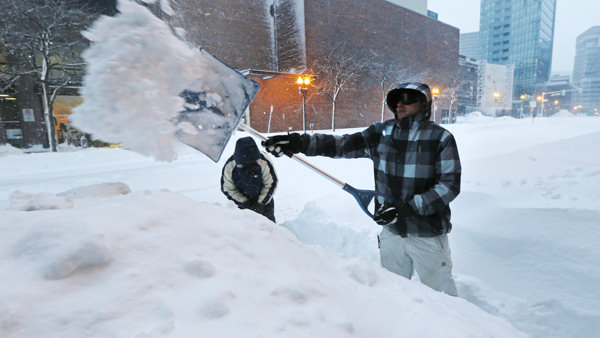 Andrew Laliberte, of Billerica, Mass., digs a pathway through a high snow drift in Boston, Saturday, Feb. 9, 2013. The Boston area received about two feet of snow from a winter storm. &#40;AP Photo&#47;Charles Krupa&#41;     <span class=meta>(AP Photo&#47;Charles Krupa)</span>