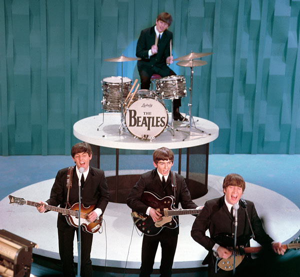 "The Beatles perform on the ""Ed Sullivan Show"" in New York on February 9, 1964. From left, front, are Paul McCartney, George Harrison and John Lennon. Ringo Starr plays drums. (AP Photo)"