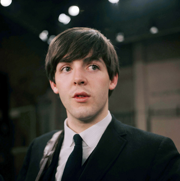 Paul McCartney, bassist for the Beatles, is shown on the set of the Ed Sullivan Show, Feb. 1964. (AP Photo)