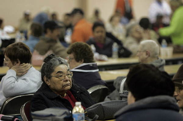 "<div class=""meta ""><span class=""caption-text "">Some of the residents of the neighborhood around 13th and Allen Streets in Allentown wait inside the Agri-Plex at the Allentown Fairgrounds after they were evacuated from homes when an explosion and fire rocked the block in Allentown, Pa., early Thursday Feb.10, 2011. Fire Chief Robert Scheirer said the fire consumed an entire row of homes and at least two people were unaccounted . In all about 500 to 600 people were evacuated, including elderly residents of a high rise. While firefighters continued to battle the blaze into Thursday, the chief predicted eight houses would be lost and another 16 damaged. (AP Photo/ AP Photo/Rich Schultz)</span></div>"