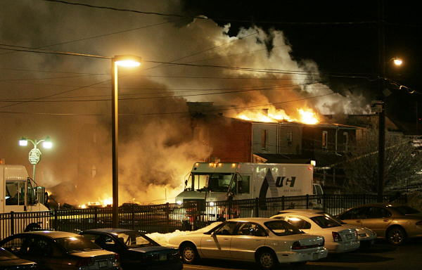 A fire rages out of control after an explosion near the intersection of 13th and Allen Streets in Allentown, Pa., early Thursday Feb. 10, 2011. Several buildings are involved and at least two people are still unaccounted for. About 750 people, including elderly residents of a high rise, were cleared from the area. Many were taken to the Allentown fairgrounds for temporary refuge.  <span class=meta>(AP Photo&#47; AP Photo&#47;Rich Schultz)</span>