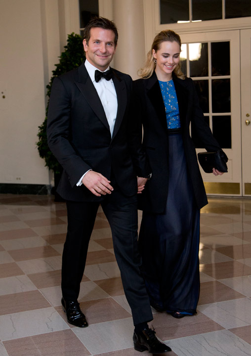 Actor Bradley Cooper, and Suki Waterhouse arrive for a State Dinner in honor of French President Fran?ois Hollande, at the White House in Washington, Tuesday, Feb. 11, 2014. (AP Photo/Manuel Balce Ceneta)