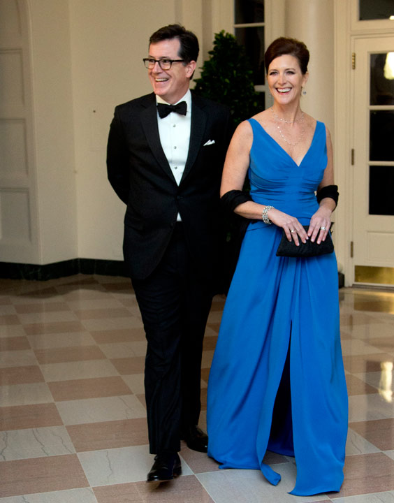 Stephen Colbert and Evie Colbert, arrive for a State Dinner in honor of French President Fran?ois Hollande, at the White House in Washington, Tuesday, Feb. 11, 2014. (AP Photo/Manuel Balce Ceneta)