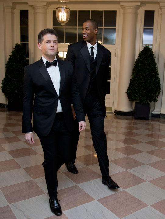 Brunson Green, left, and Jason Collins arrive for a State Dinner in honor of French President Fran?ois Hollande, at the White House in Washington, Tuesday, Feb. 11, 2014. (AP Photo/Manuel Balce Ceneta)